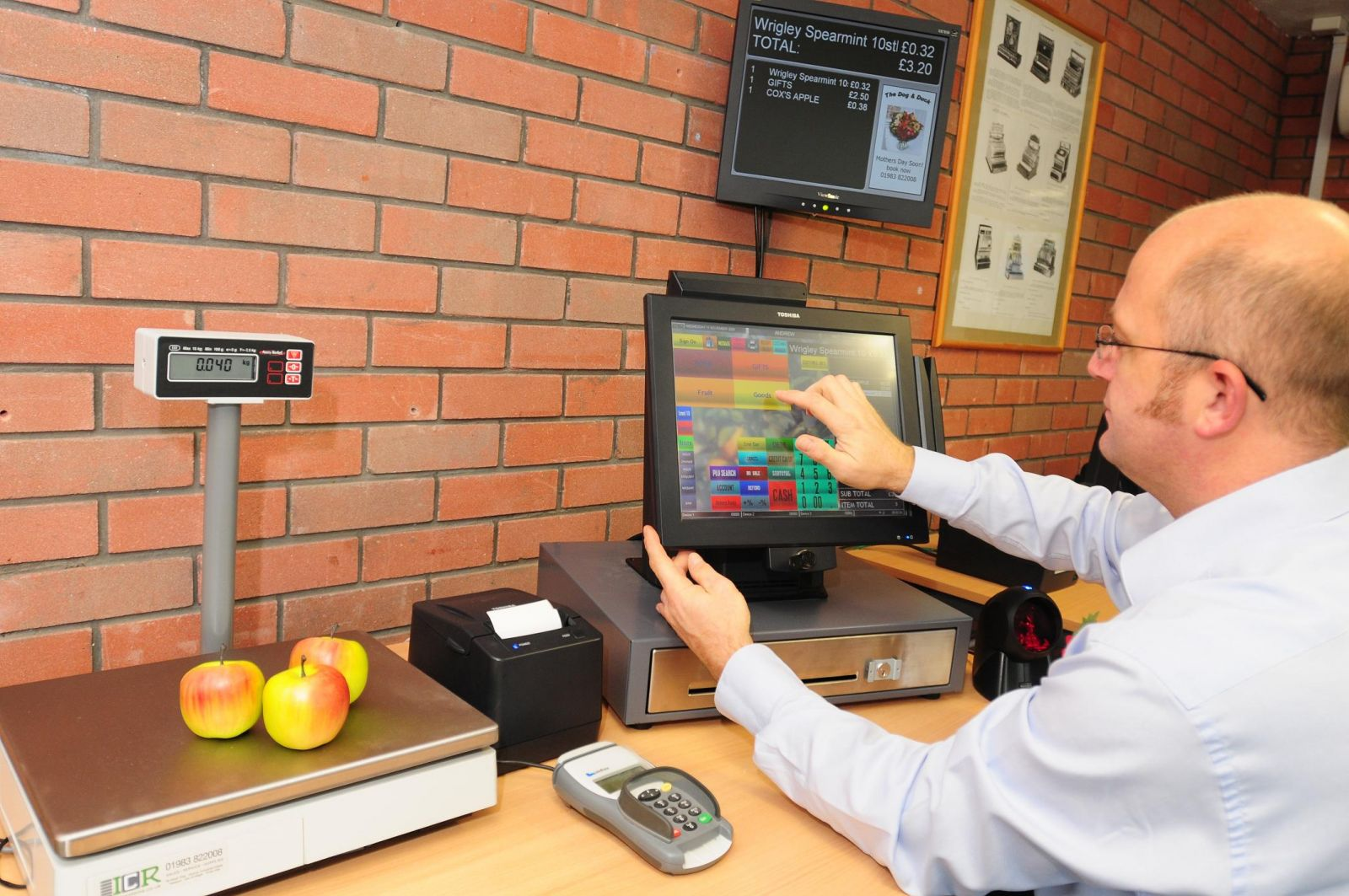 Retail touch screen terminal linked to EFT and a Scale